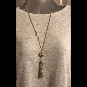 Gold tone ball and tassel necklace